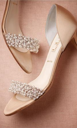 Badgley Mischka Dawn Wedding Shoes Dawn by Badgley Mischka. Dawn is a satin platform ankle strap d'orsay heel with a glamorous vintage-inspired decoration at the back of the heel. The evening shoe features a sturdy platform and peep-toe. The showstopper on this style is the rhinestone decoration; the sophisticated sparkle is sure to stand out.