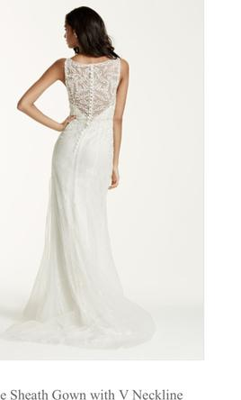 8111aa8407 Pin it · David s Bridal Lace Sheath Wedding Gown with illusion low back 10