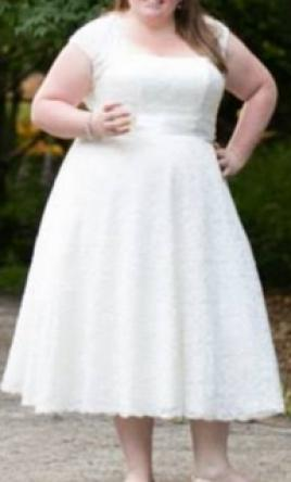 Pin It David S Bridal Tea Length Plus Size Wedding Dress With Shrug