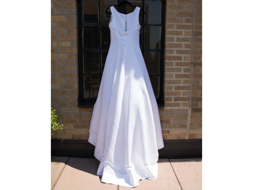 Used wedding dresses canada bridesmaid dresses for Paying for a wedding dress